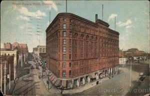 A historic postcard of the exterior of the Brown Palace Hotel.